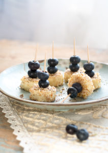 Skewered bananas with almonds and blueberries